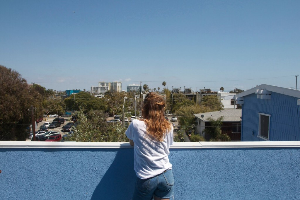 Anna Carey on her home studio balcony, overlooking Venice, LA, 2015. Image courtesy of Anna Carey